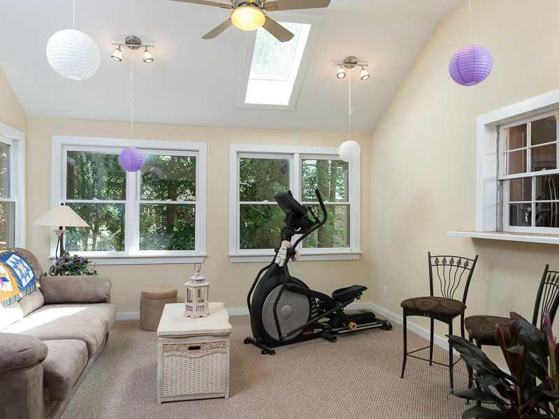 Sunroom. Vaulted ceilings, light and bright, excellent spot to read or have a kids playroom.