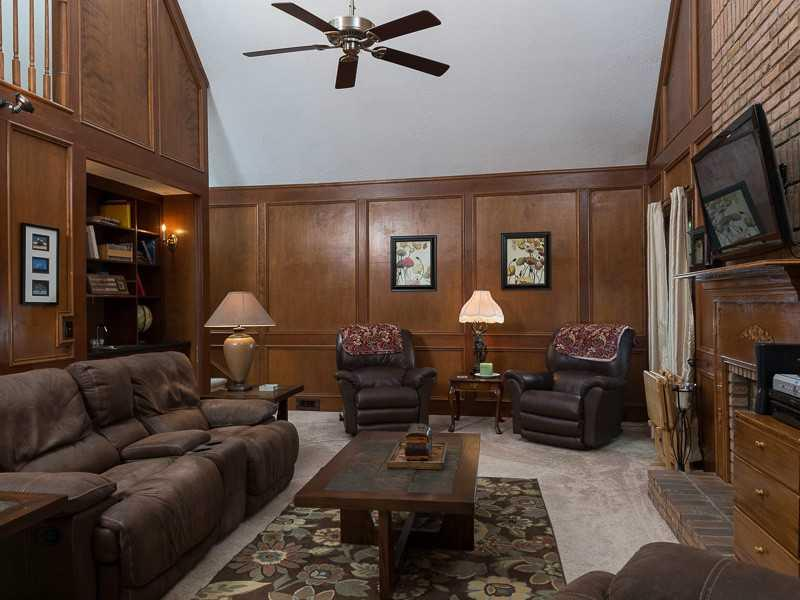 Den/Family/Great Room. Gorgeous wood paneling with vaulted ceiling, wet bar, fireplace.
