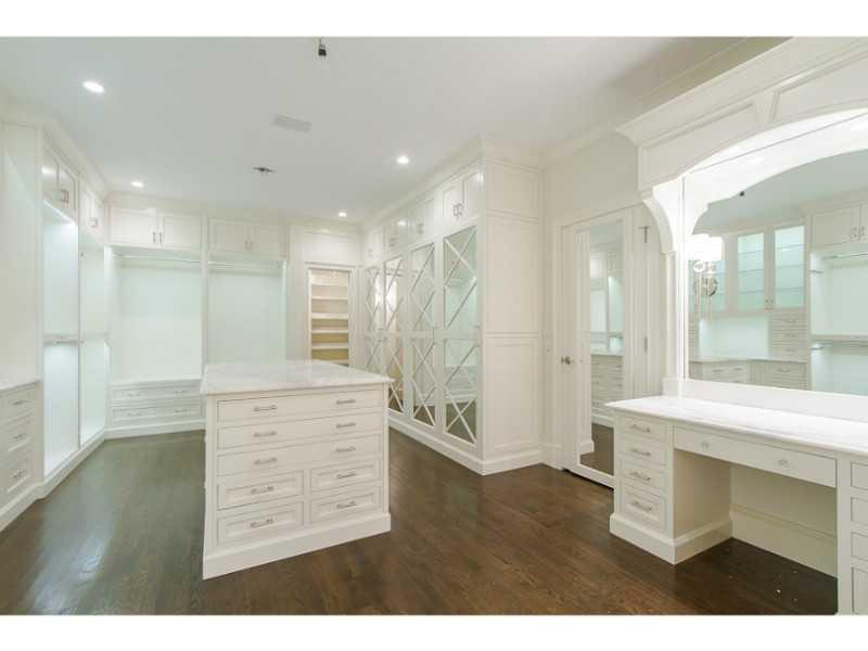 Bedroom Closet. New main floor Master Closet w/custom cabinetry, dressing table and jewelry drawers