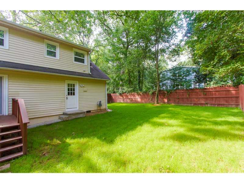 Yard/Garden. Large, flat backyard with a privacy fence.