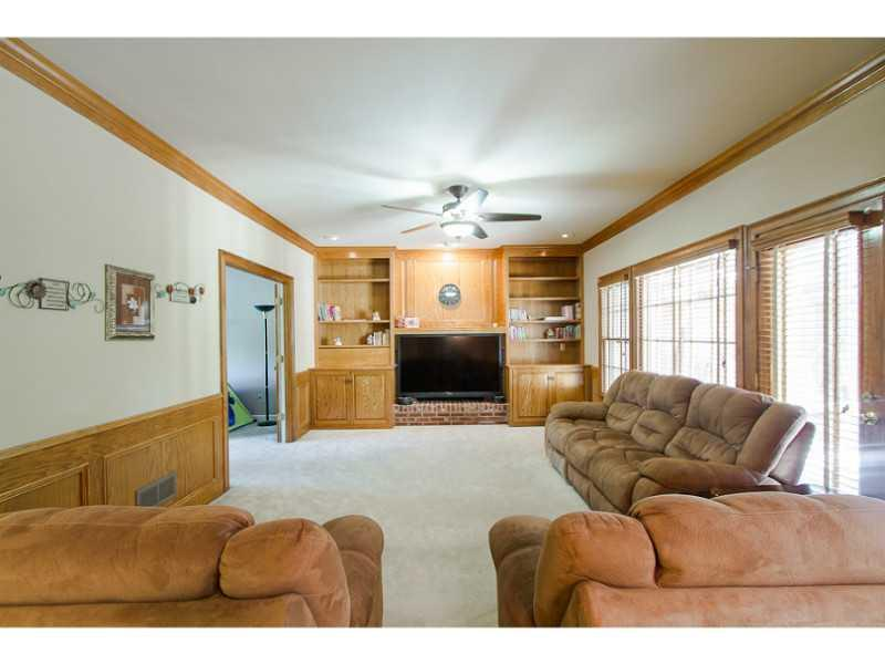 Den/Family/Great Room. Family room with built ins and access to deck area.