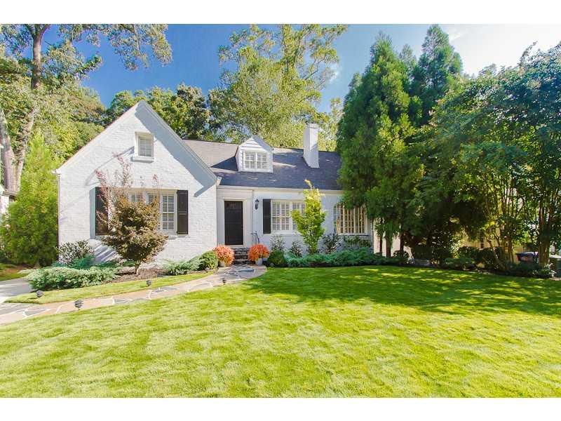 Exterior Front. Beautiful flat, landscaped front yard welcomes you to this perfect Peachtree Park home.