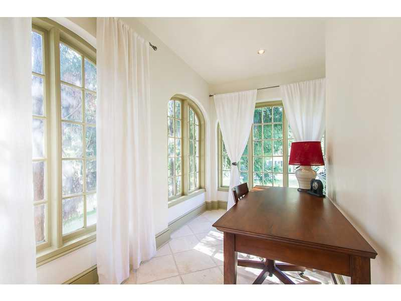Studio/Study/Office. Arched windows add such great character in this charming sunroom