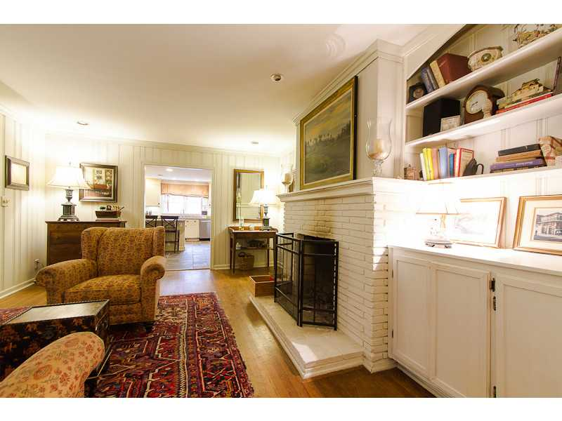 Den/Family/Great Room. Fireside family room with built in bookshelves open to kitchen and sunroon