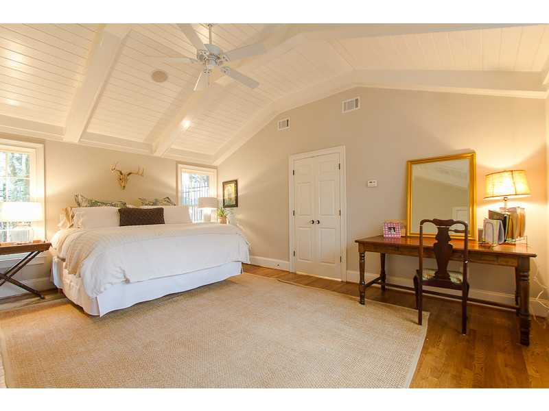 Master Bedroom. Luxurious master suite with vaulted ceiling, his and her walk in closets and exquisite master bathroom