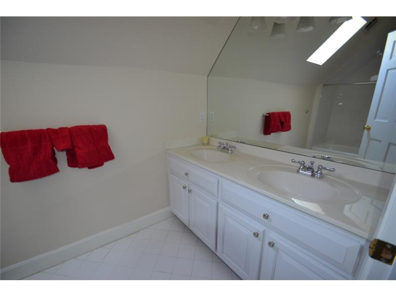 Bathroom. Upstairs Guest Bedroom has private bath with double vanities and tub/shower combo.