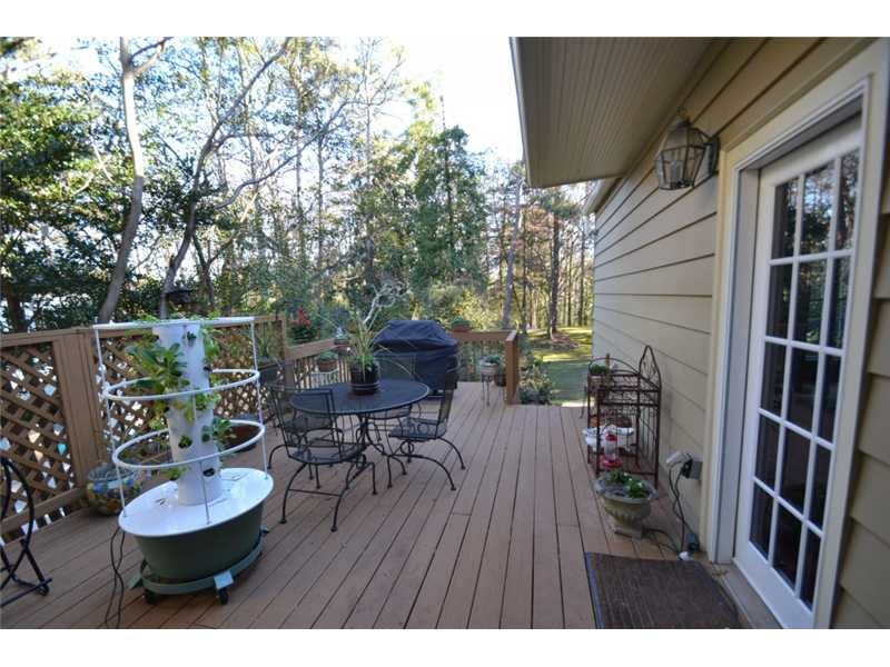 Patio/Deck. Deck with access to Formal Dining Room or Kitchen/ Den.