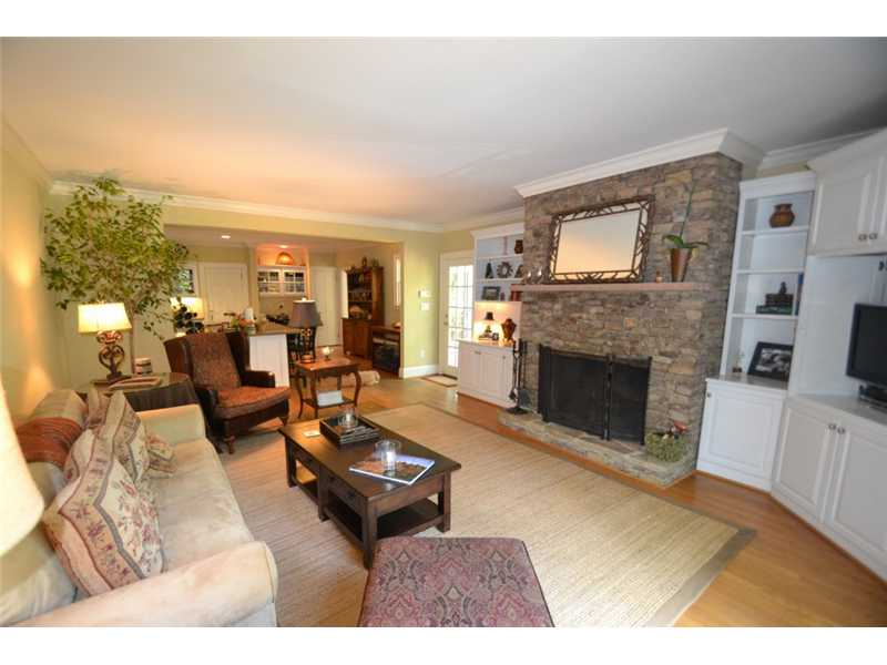 Den/Family/Great Room. Den with great views overlooking the backyard features a stacked stone, gas fireplace, built-ins and access to the deck.