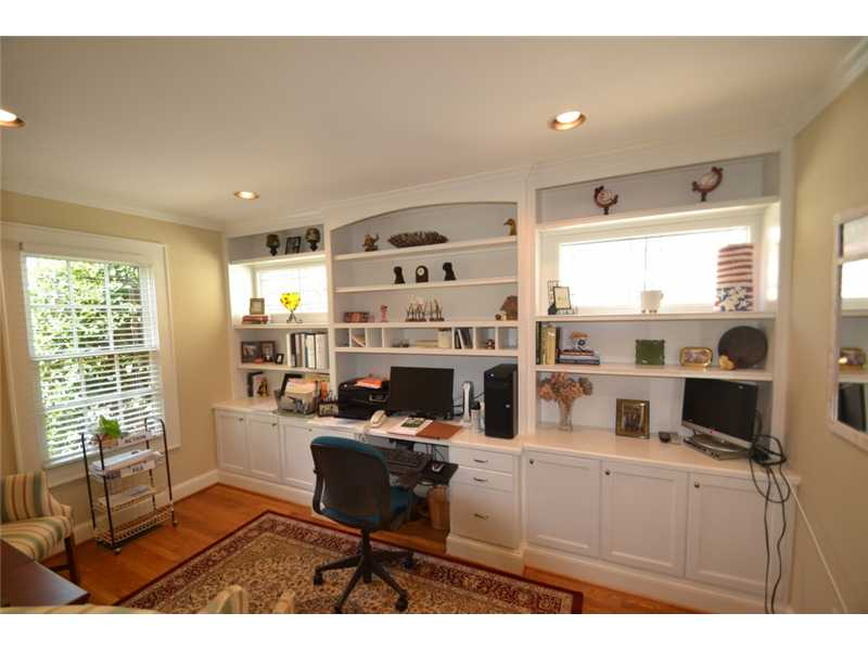 Sunroom. Bright office with built-ins.