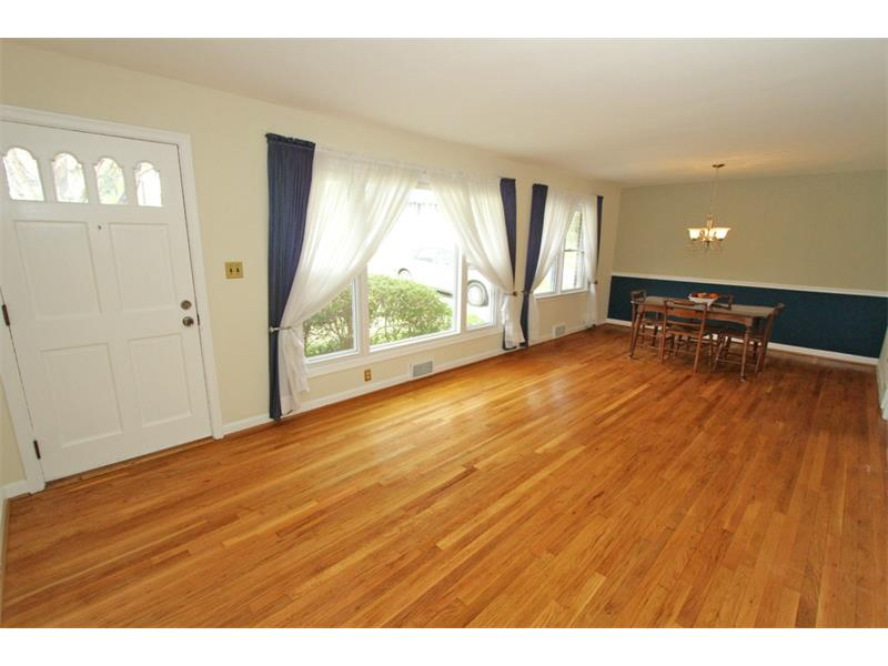 Gloriously Shine To These Hardwood floors. Living Room Dining Room