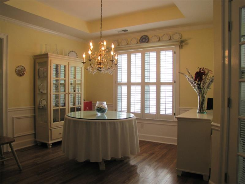 Separate but open dining room with hardwood floors.