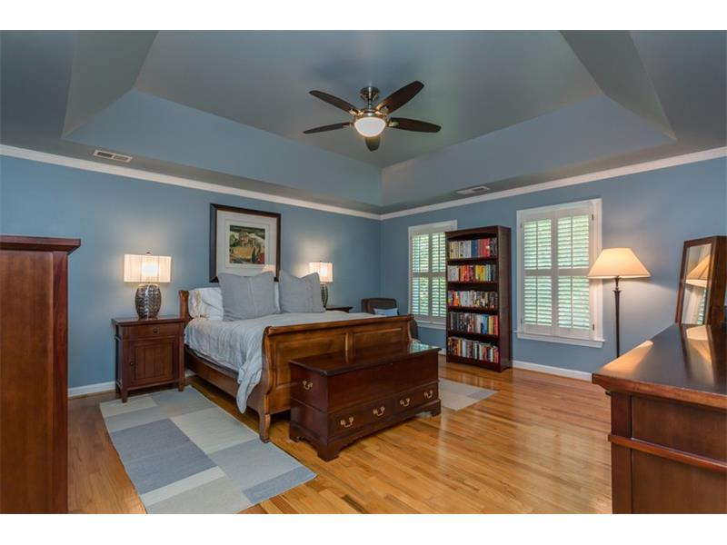 MASTER SUITE: Unwind in privacy after a long week in your new personal oasis! Located on the upper level, the Master Suite features hardwood flooring, an extra deep trey ceiling with fan-light combo and wood shutters.