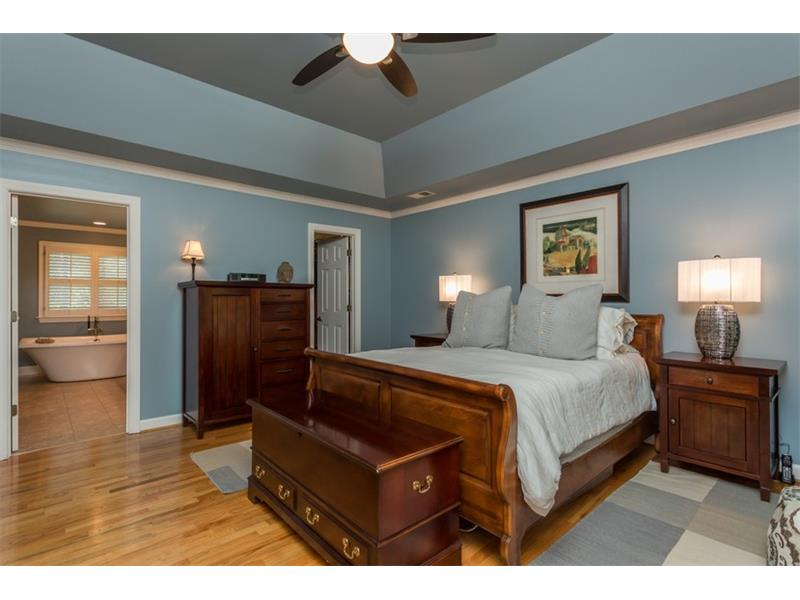 MASTER SUITE: The sizable walk-in closet includes carpet, built-in shelving and a window overlooking the backyard.