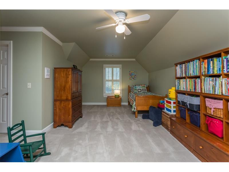UPPER LEVEL: The oversized third bedroom would also make a great play room, media room or even a home office.