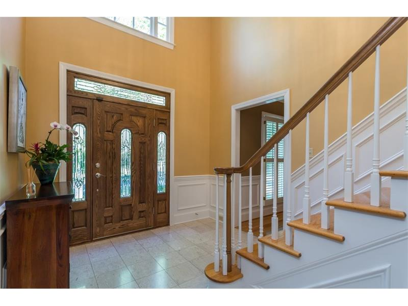 ENTRANCE FOYER: You are welcomed into the home by the two story entrance foyer with lovely picture molding, a double trey ceiling with crown molding, an elegant chandelier and hardwood stairs that lead to the upper level.