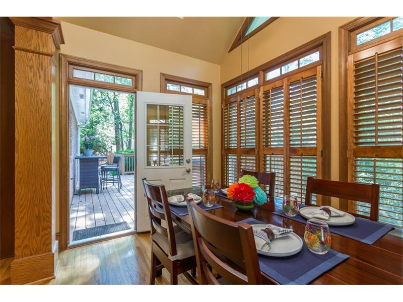 BREAKFAST ROOM: The spacious breakfast room is large enough to comfortably seat 8 or more guests and three full walls of windows fill the main level with bright, natural sunlight. The breakfast room also has wood shutter blinds and a vaulted ceiling