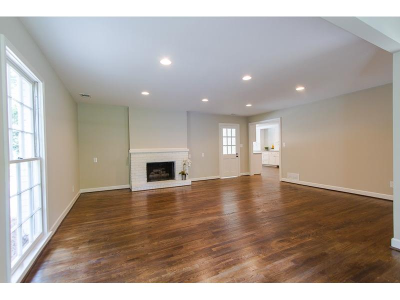 Bonus Room/Keeping Room located off kitchen with Gas log Fireplace and Powder Room.