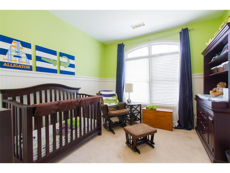 Picture perfect nursery with decorative wainscoating.