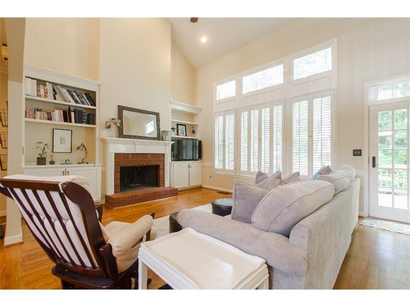Fireside family room with lots of natural light and custom built in bookshelves and storage.