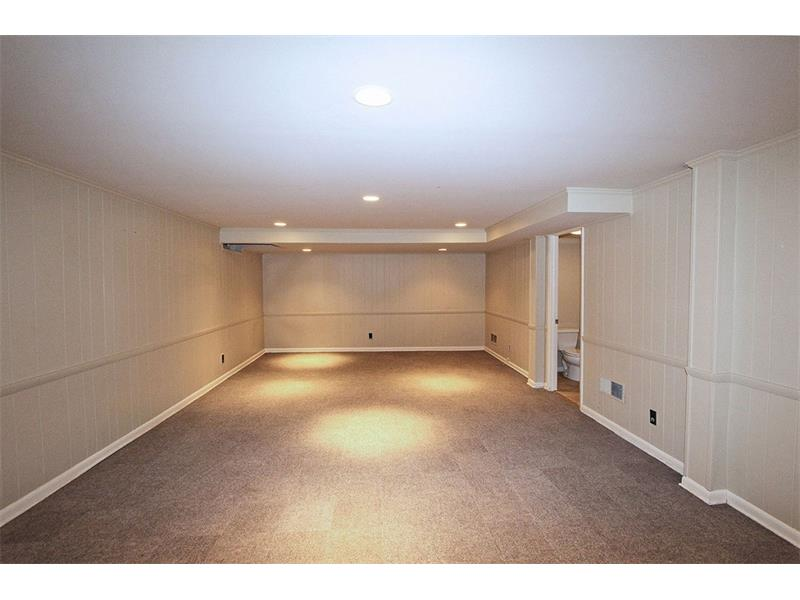 Large Basement Playroom with Full Bath.  Also a Spacious Unfinished Area for extra storage.