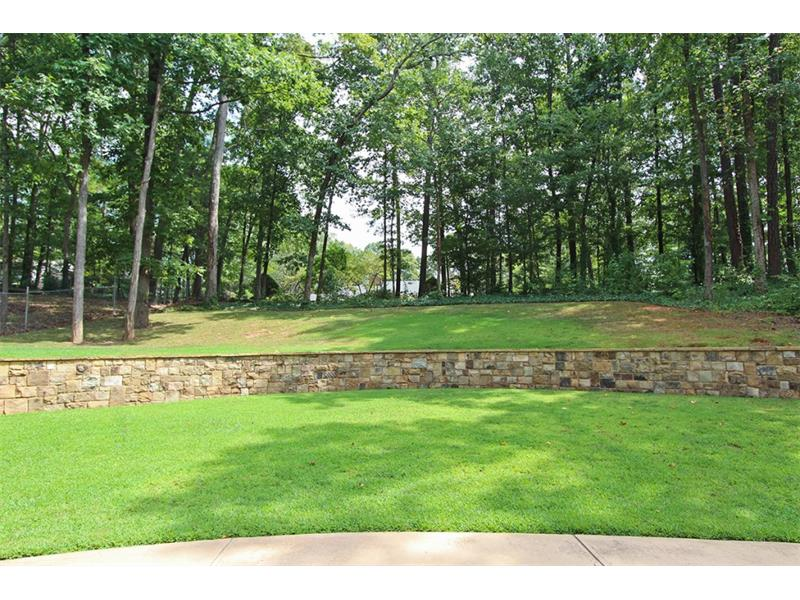 Current Owners built this beautiful Stone Wall.  Plenty of Play Space beside Patio and Lots of Privacy.