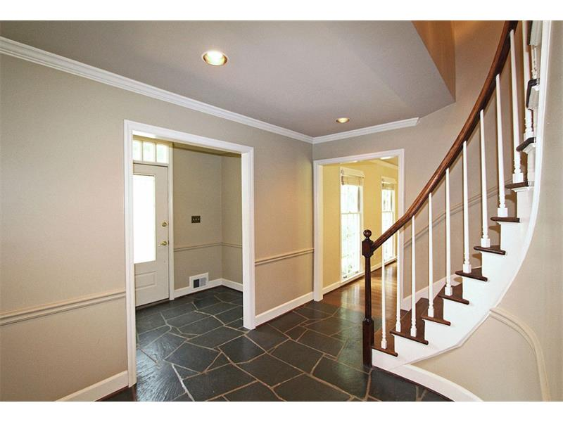 Slate Foyer leads to beautiful Circular Staircase.