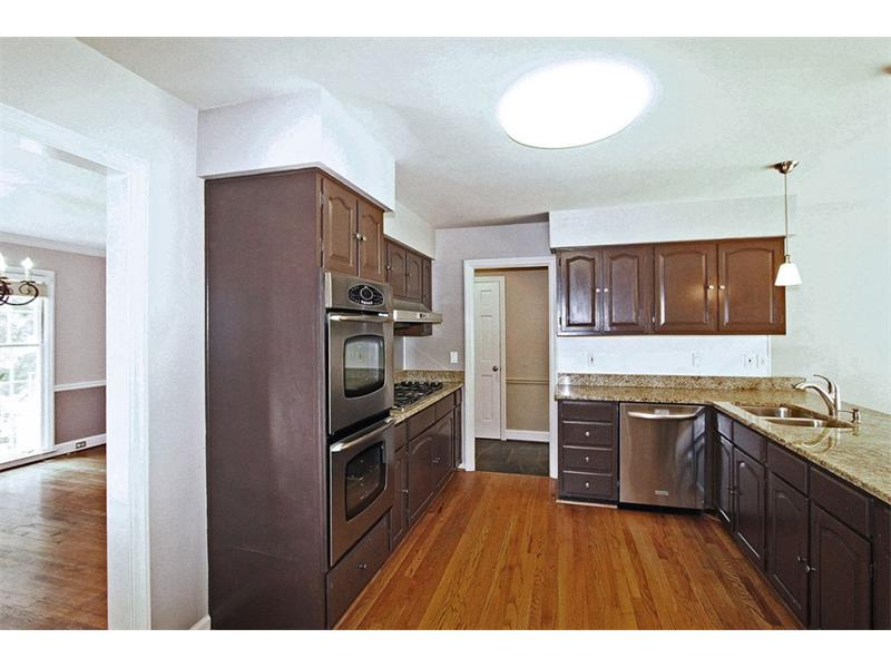 Newer Stainless Appliances and Granite Countertops.  6 Burner Gas Cooktop