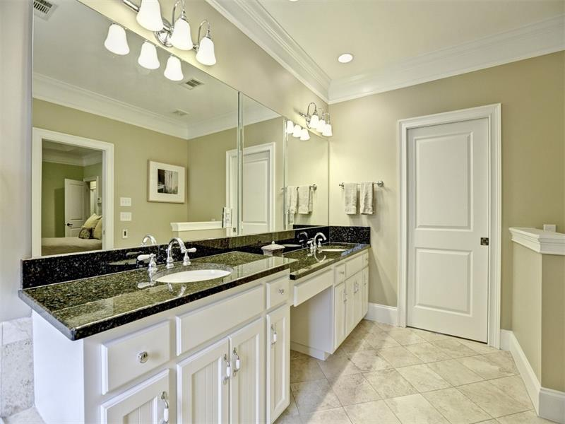 Plenty of room for two to get their day started in this bathroom. His and her sinks and two shower heads sure help, not to mention the huge walk-in closet and heated floors for those chillier temperatures.