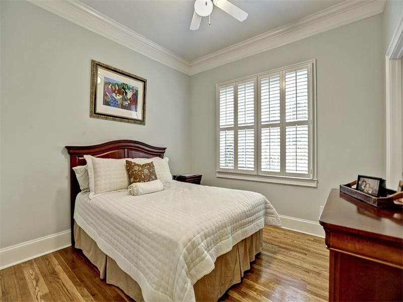 This is the bedroom on the main complete with plantation shutters, hardwoods, a walk-in closet, hidden storage in the back of the closet and plenty of room for a king bed.