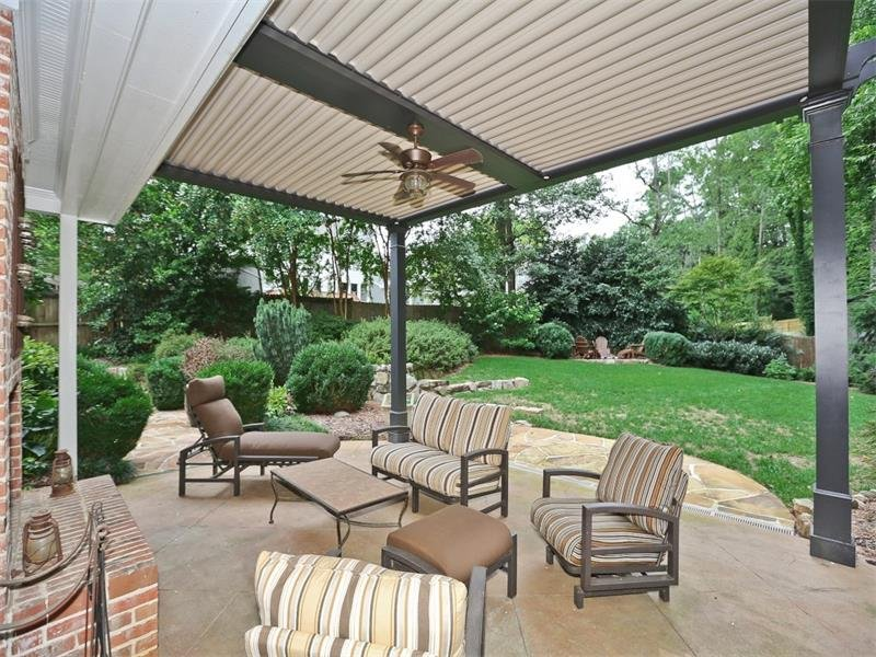 Private and charming back yard. The remote controlled, louvered ceilings and the masonry brick fireplace with gas starter ensure you can use this porch all year long regardless of the weather!