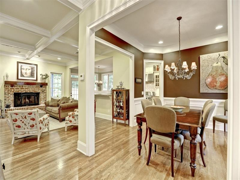 Welcome! The open floor plan greets your guests and makes them feel right at home. The large dining room off the kitchen is the perfect place to enjoy social gatherings. The brick, masonry fireplace warms the room on chilly nights.