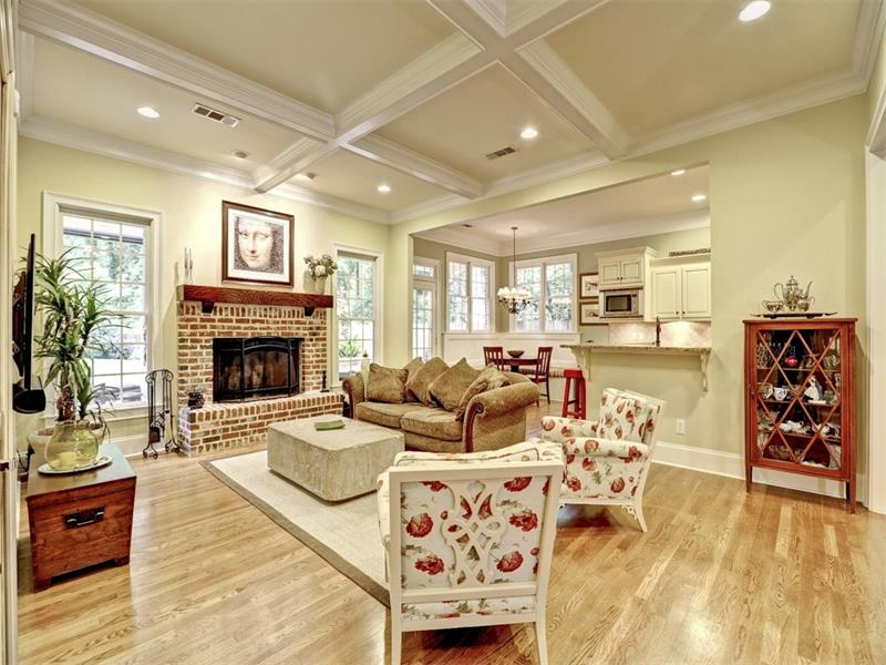 The inviting family room with boxed beam ceilings and beautiful hardwoods is open to the kitchen. And, it has a great view of the backyard - wait until you see the backyard!
