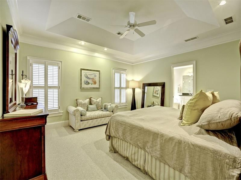 The master suite is perfect! Plantation shutters, seating area, plenty of room to large furniture and an en suite bath that's sure to help you relax after a long day.