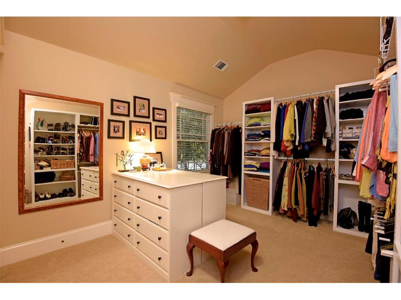 This is a actually a secondary bedroom that has been converted to another master closet.  This can/will be easily converted back to a bedroom if you choose not to use it as a closet.