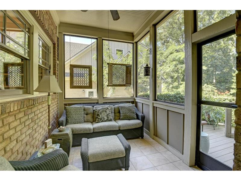 This lovely screened porch is off the kitchen.