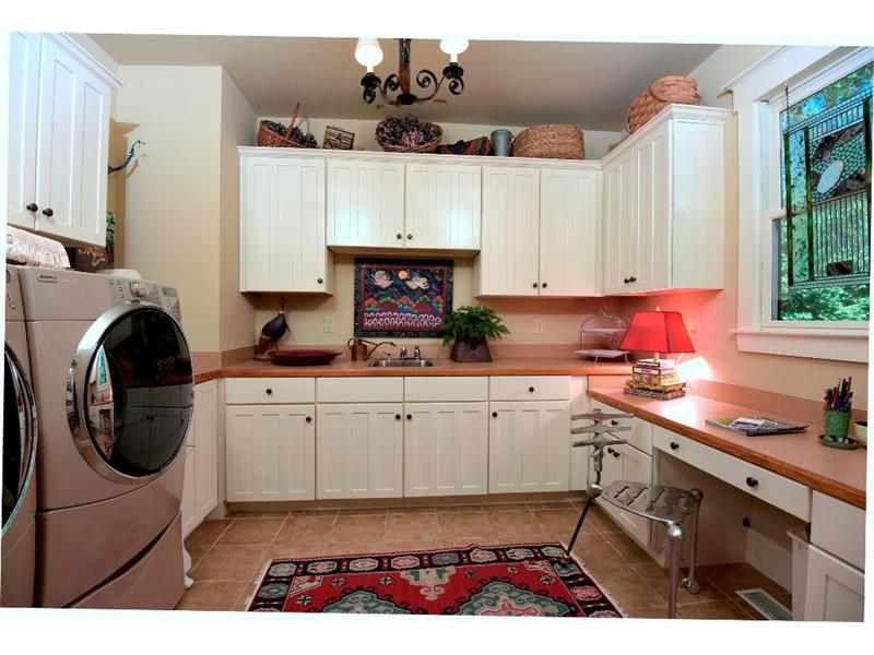 Butlers pantry and laundry. This room provides so much more kitchen storage you will be amazed.