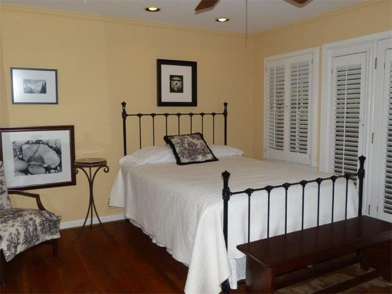 Large bedroom with glass doors to backyard also features ample closet storage.