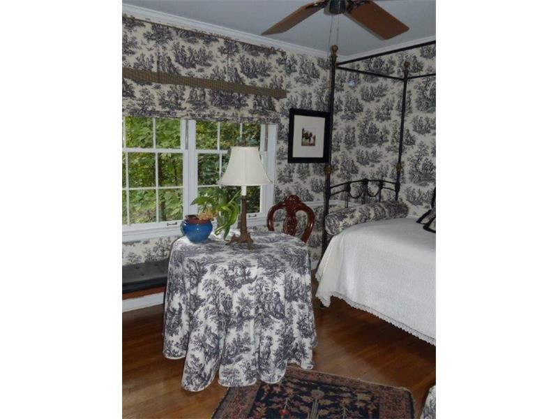 Second bedroom on main level with exquisite views of private front yard .