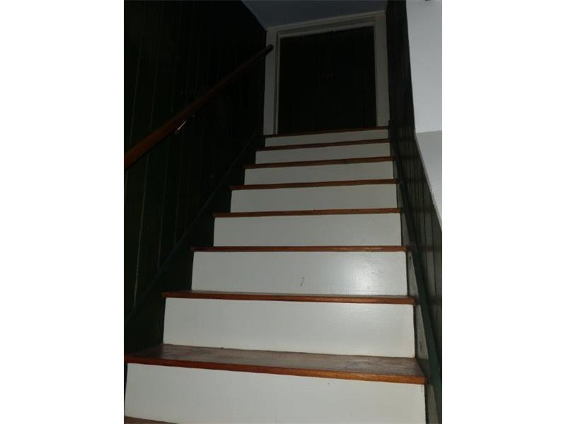 Permanent stairs to attic storage from den.