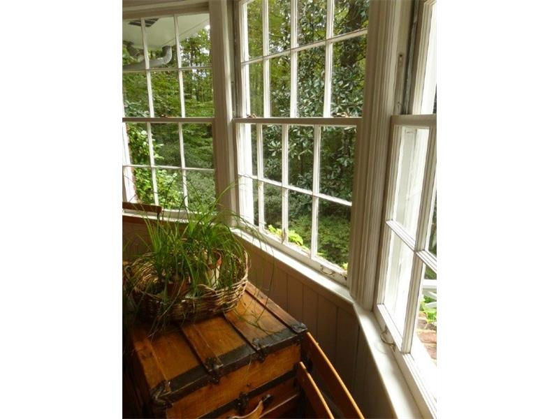 Large front bay window is original to home, views to front yard are green an private.