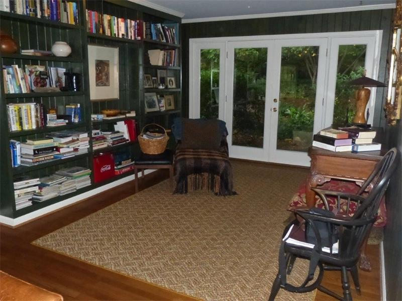 Library has wood paneling and is walk out to backyard, features hardwood floors and gorgeous views.