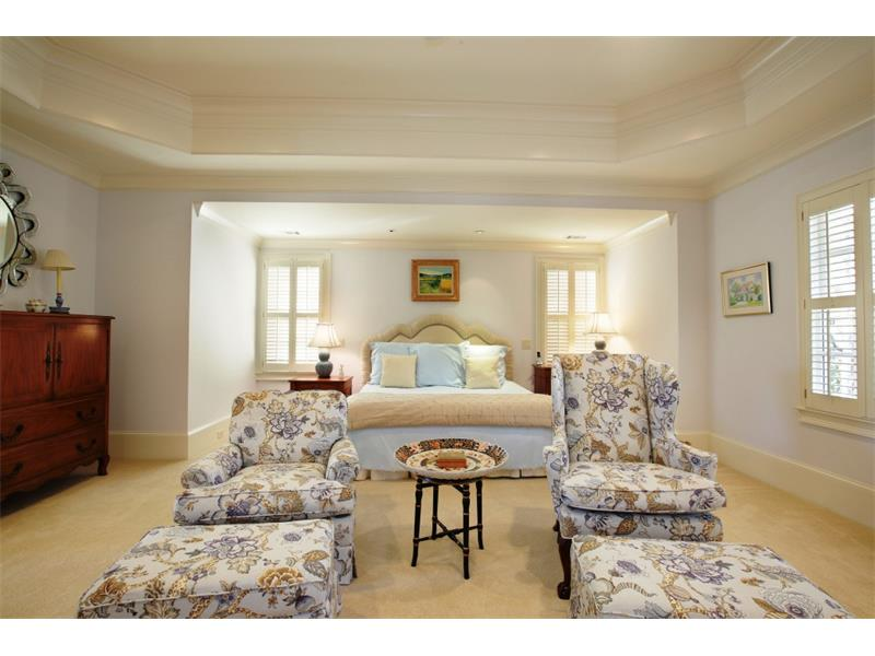 Master Suite. The master bedroom is very spacious with large separate his and her closets.