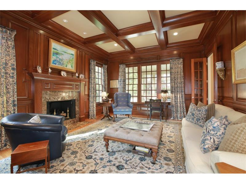 Gentleman's Study. This elegant study, that is custom designed, includes a fireplace and coffered ceilings.