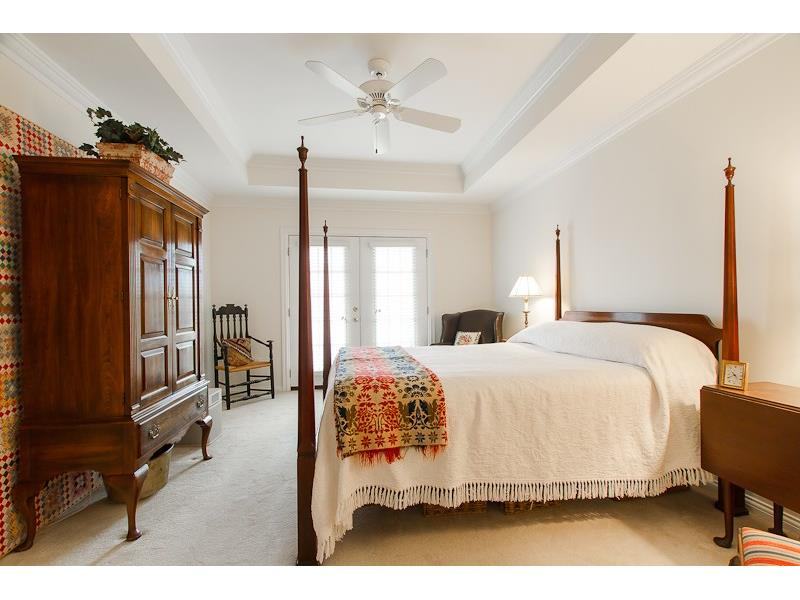 LARGE MASTER SUITE WITH FRENCH DOORS OPENING ONTO THE COVERED PORCH.