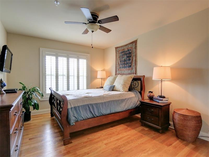 Master bedroom with hardwood floors.