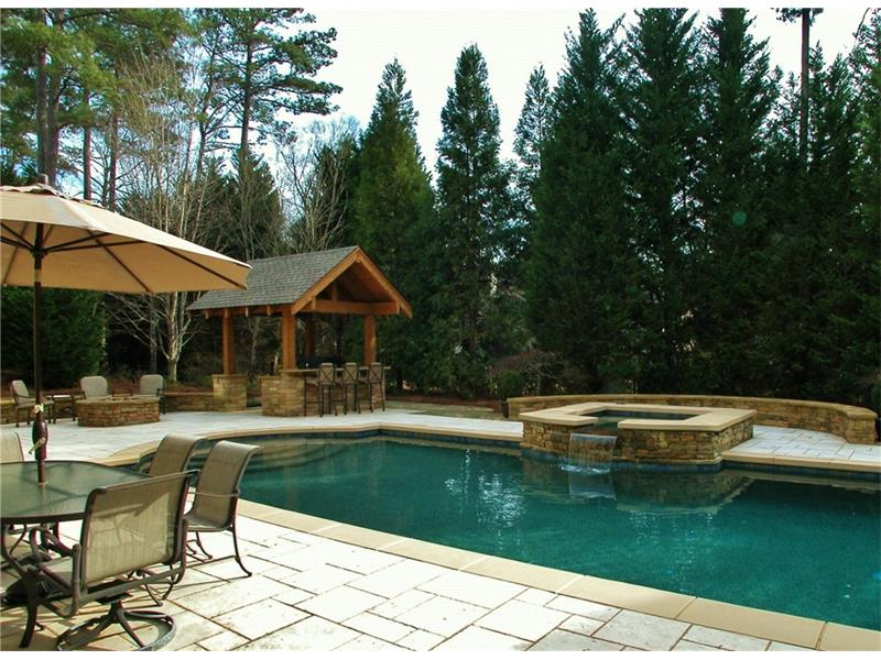 Sparkling Pool and Spa adjoining Fabulous Outdoor Kitchen and Firepit