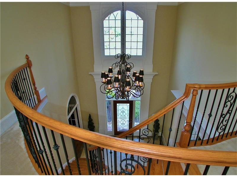 Stunning Two Story Entryway with Circular Staircase