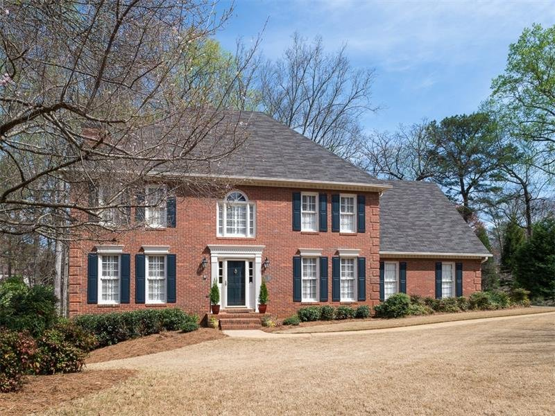 Beautiful Brick Traditional with excellent curb appeal, plantation shutters & side entry garage