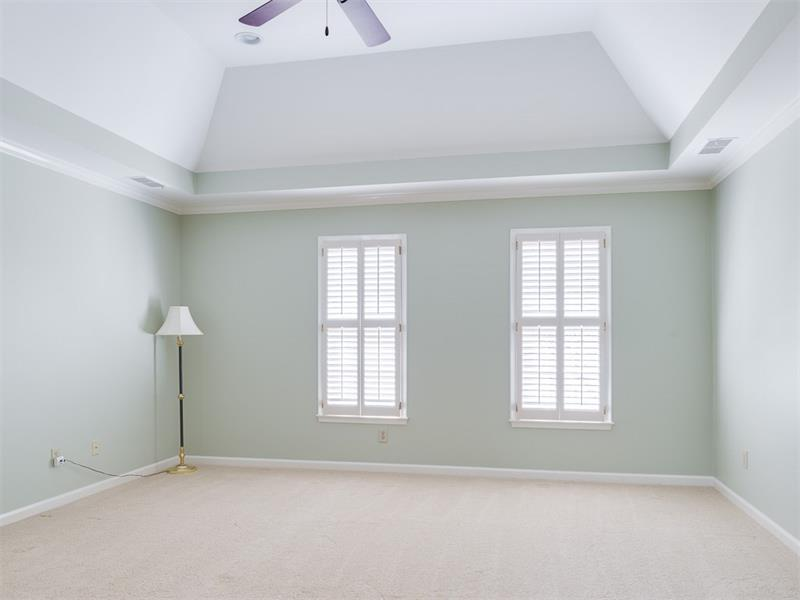 Large Master Bedroom trey ceiling, recessed lighting & plantation shutters