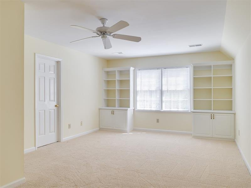 Bright Upstairs Bedroom #3 with large walk-in closet and built-in bookshelves